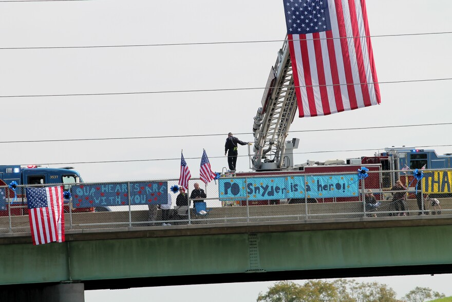 Supporters paid their respects for Officer Snyder and his family by lining the overpasses along the way to his grave site in Illinois.