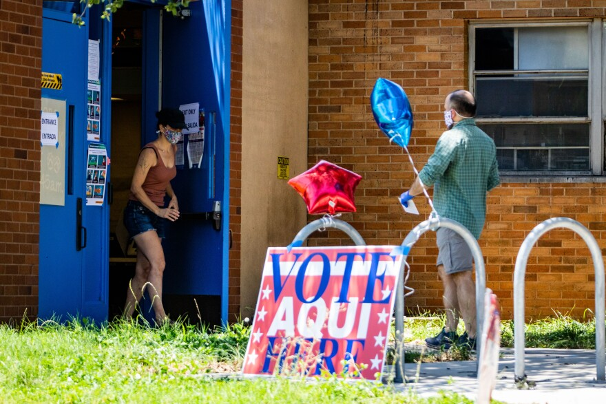 Voters wear masks as they enter a polling location on Election Day.