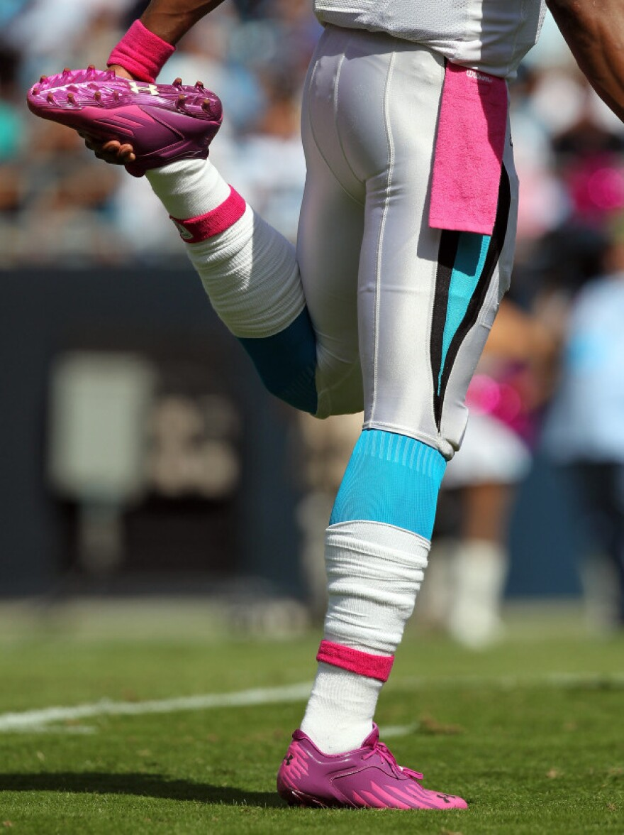 <p>Cam Newton #1 of the Carolina Panthers stretching as he wears pink for breast cancer awareness during their game at Bank of America Stadium in October.</p>
