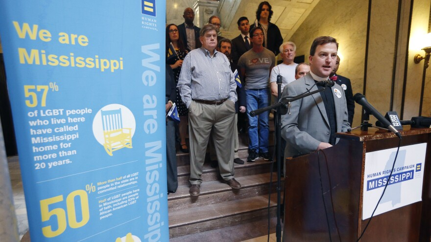 The Rev. Chris Donald, a Methodist chaplain at Millsaps College, joins other human rights advocates Wednesday at the state Capitol's rotunda, calling for the Mississippi Senate to defeat what they believe is a discriminatory anti-LGBT bill. The Senate passed the bill, which is now on the governor's desk.