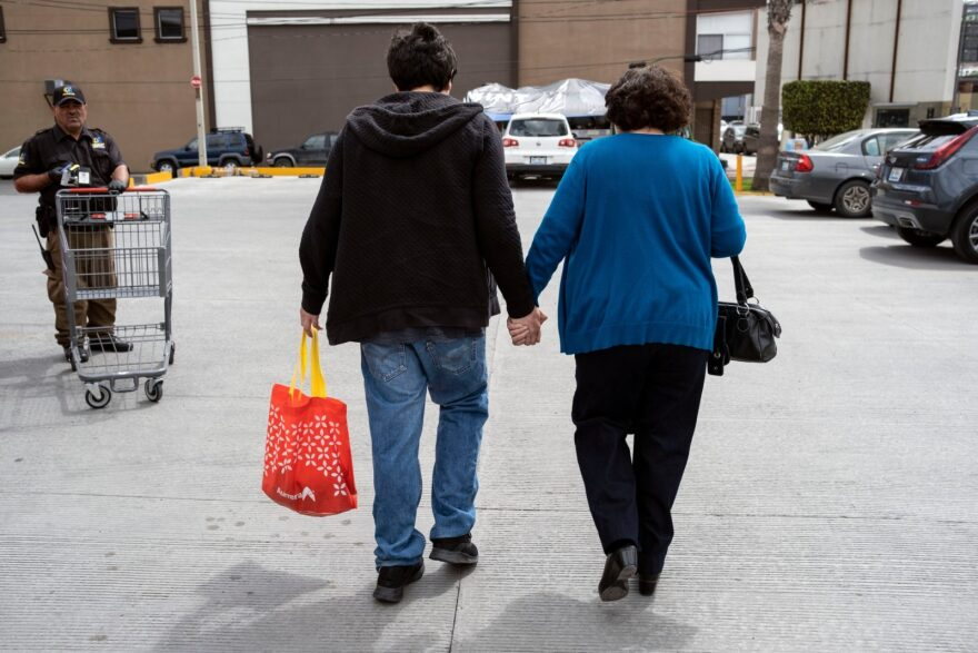 Mexican Angel Arteaga has autism. Here, he holds hands with his mother Leonor (R) as they walk back to their car after going out from a store during the COVID-19 outbreak in Tijuana. Angel's daily routine was affected by the quarantine he and his family have kept.