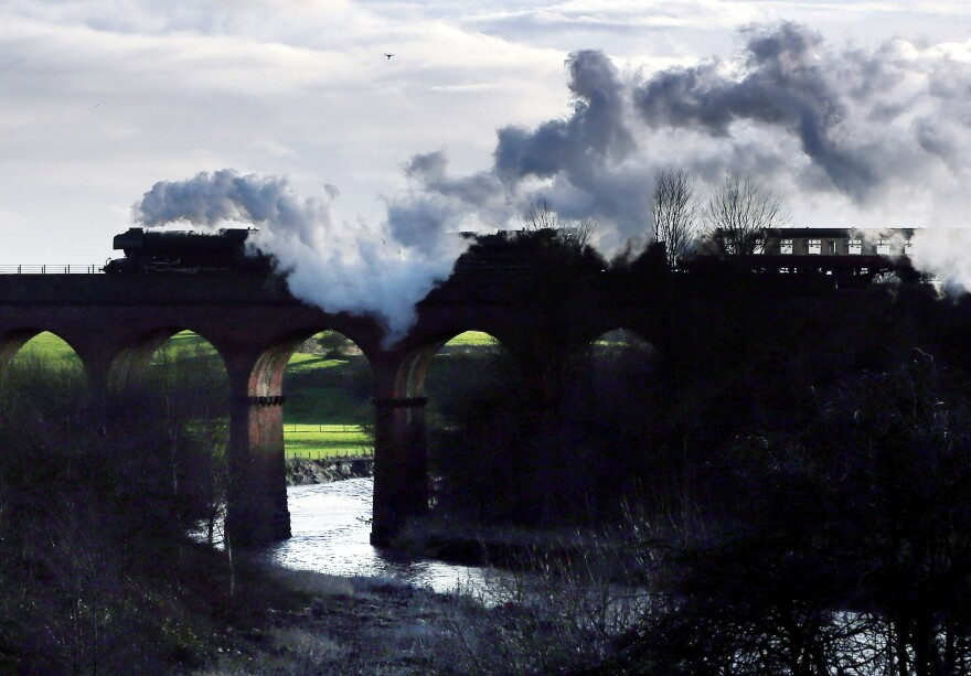 The Flying Scotsman crosses a viaduct during a test run along the East Lancashire line in Bury, England. The legendary locomotive has been brought back to life so it can be exhibited at the National Railway Museum in York.