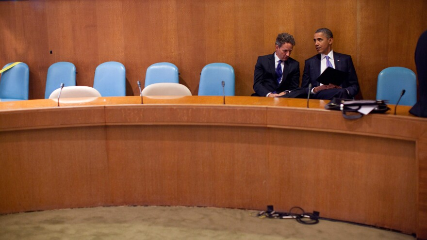 In this handout image provided by the White House, President Obama talks with Treasury Secretary Timothy Geithner at the United Nations on Sept. 23, 2010.