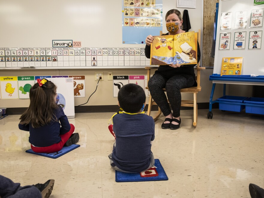 Thousands of pre-kindergarten and some special education students in Chicago Public Schools returned to in-person learning earlier this month. Pre-kindergarten teacher Angela Panush reads a story to her students at Dawes Elementary on January 11.