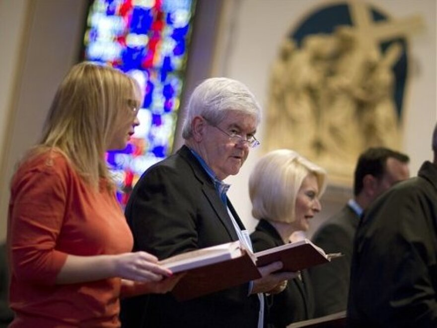 Newt Gingrich attends Catholic Mass at St. Ambrose Cathedral on Sunday in Des Moines, Iowa, with his wife, Callista, right.
