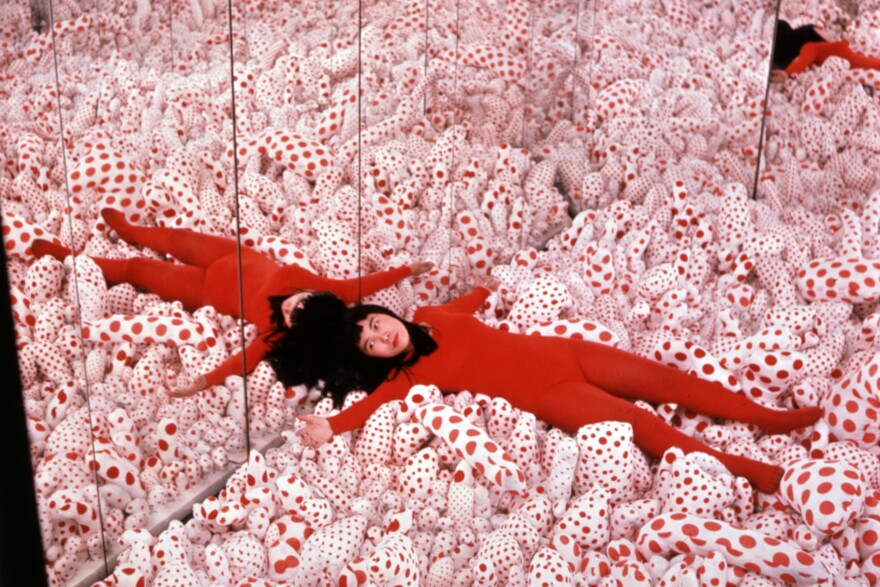 """Yayoi Kusama in her <em>Phalli's Field</em> infinity room in 1965. Art dealer Richard Castellane says Kusama """"shocked the living daylights out of people"""" with her art."""