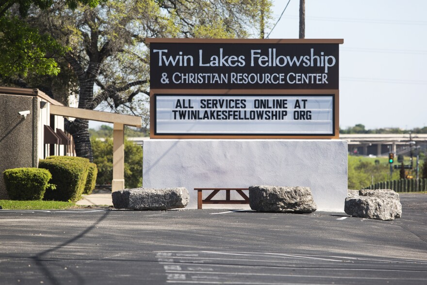 A sign at Twin Lakes Fellowship in Cedar Park says services are available online during the coronavirus pandemic.