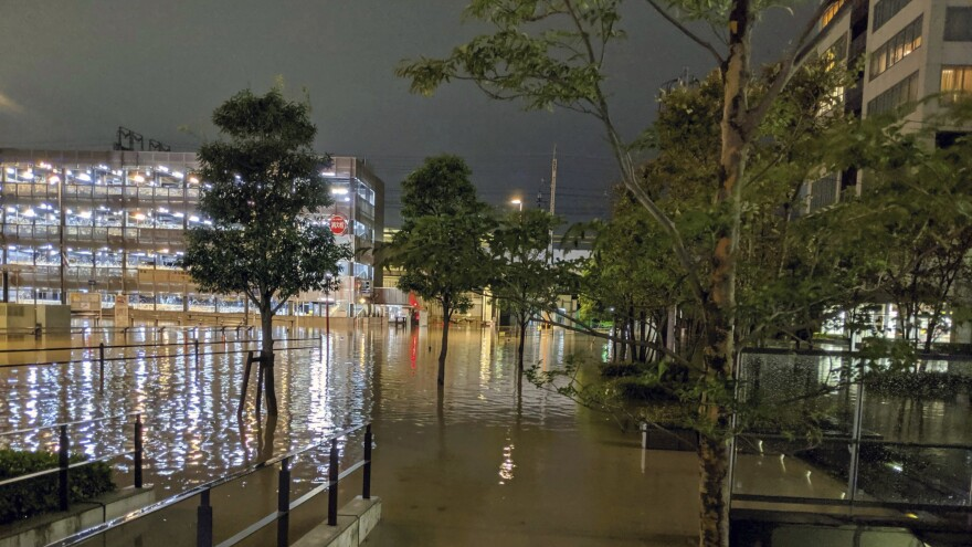 The streets in Kawasaki, near Tokyo, flooded after Typhoon Hagibis made landfall Saturday. Helicopters plucked people from their flooded homes on Sunday as rescue efforts went into full force in wide areas of Japan.