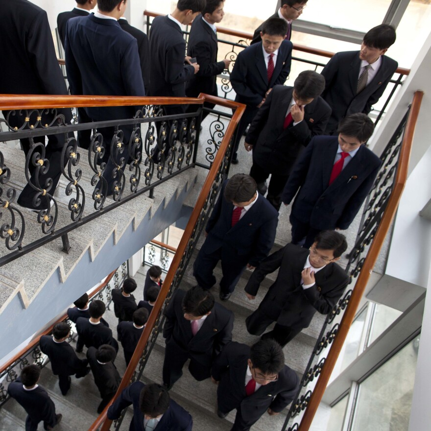 Students at Pyongyang University of Science and Technology descend the stairs after a lecture in October 2011.
