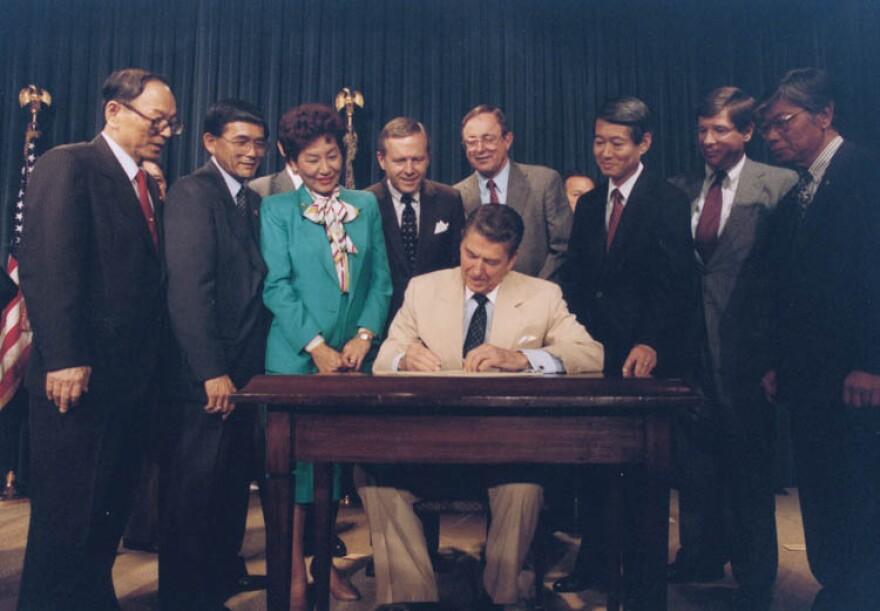 reagan signs japanese reparations.jpg