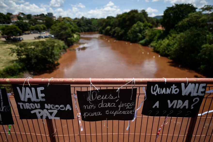 Residents and relatives of victims place messages on the bridge over the Paraopeba River, during a tribute to those who died after a tailings dam collapsed in the town of Brumadinho, Brazil.