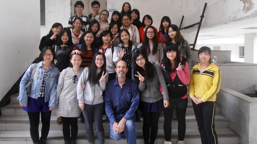 Foster poses with his students at Guangdong University of Foreign Studies.