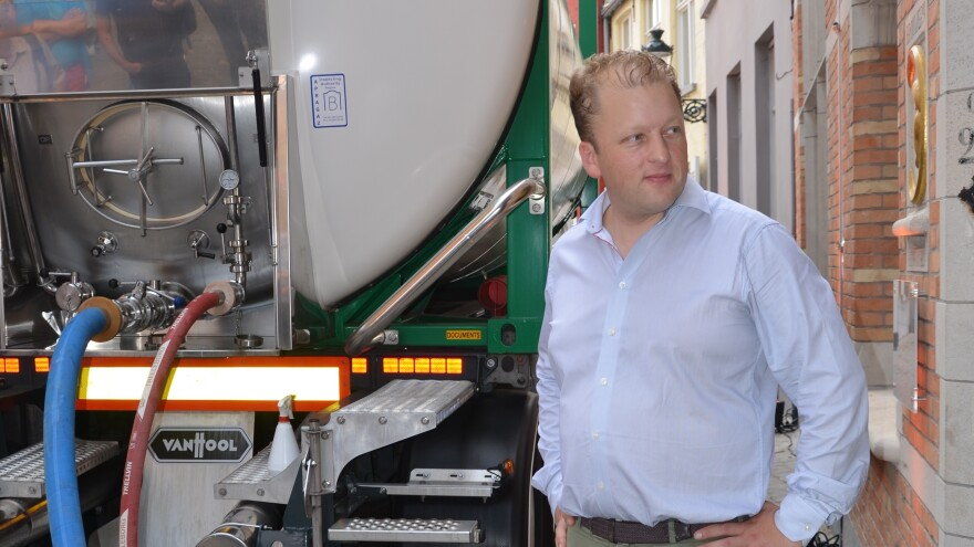 De Halve Maan brewery director Xavier Vanneste looks on as the last beer tanker prepares for its trip. The brewery will now transport beer using a pipeline.