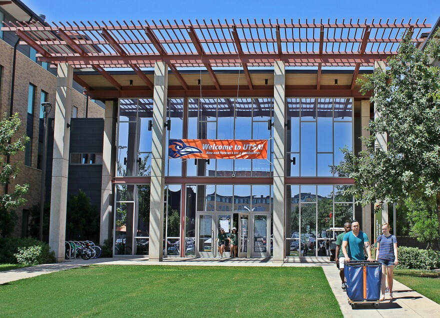 File Photo. Students walk out of UTSA's Alvarez Hall to pick up another load of  belongings during move-in day in Fall 2018.