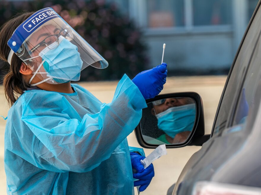 A medical worker administers a rapid Covid-19 test in Oakland, Calif. on Oct. 12, 2020. Coronavirus cases are once again surging across much of the country, reaching almost 100,000 on Friday.