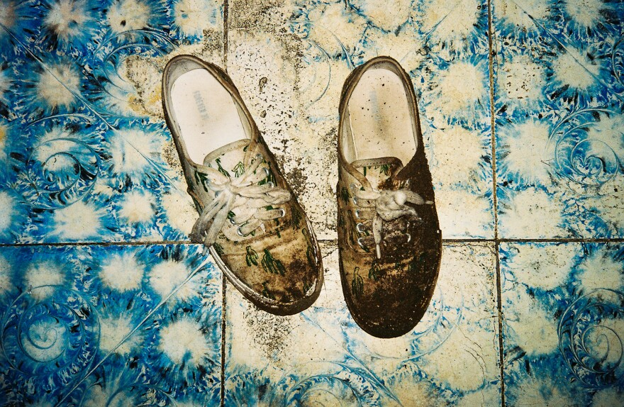 Poole's shoes, caked in mud, after crossing the Honduras border at night.