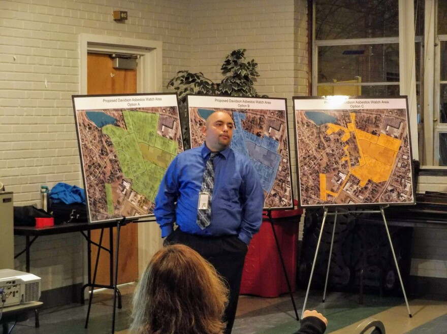 "Miguel Alvalle of the N.C. Department of Environmental Quality explains the Davidson ""asbestos watch area"" to residents Monday at the Ada Jenkins Center in Davidson."