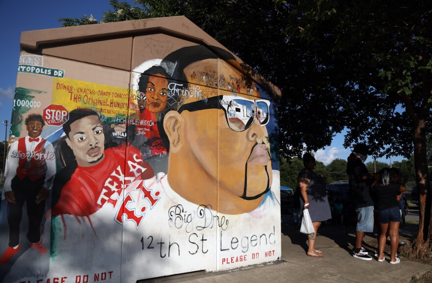 """Michael """"Malik"""" Williams' mural started as a memorial for his friend Andre Davis, but it's since grown."""