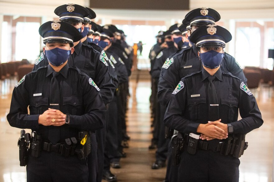 Two rows of Austin police cadets.