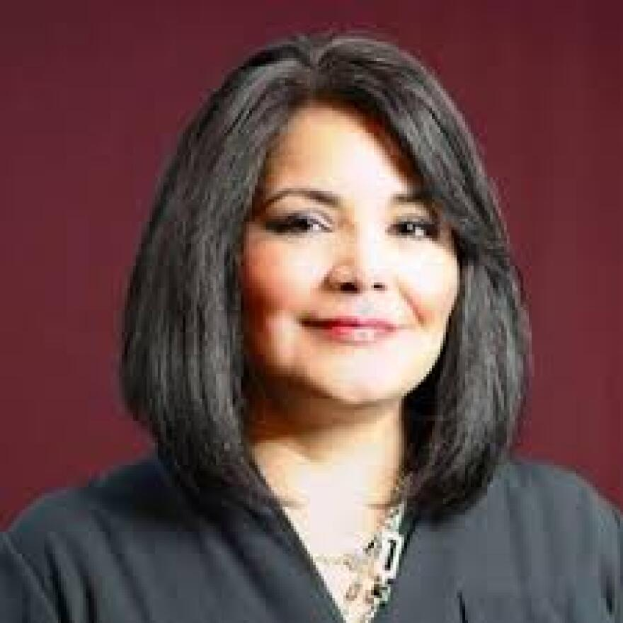 A headshot of a Hispanic woman, Kim Cordova.