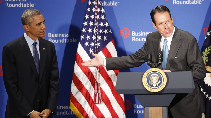 Randall Stephenson, chairman and CEO of AT&T, introduces President Obama before the latter's remarks Dec. 3 at the quarterly meeting of the Business Roundtable, a group Stephenson chairs. Stephenson has said that increasing regulation of the broadband industry — as proposed by the president — would have a substantial chilling effect on its investment in infrastructure.