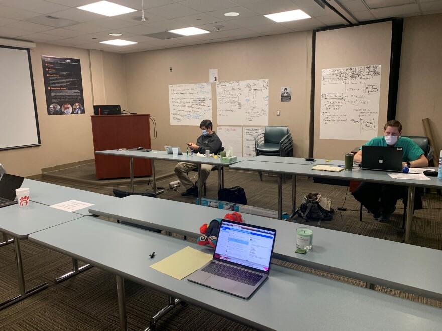 "Employees sit in Atrium Health's coronavirus ""war room"" at Carolinas Medical Center."