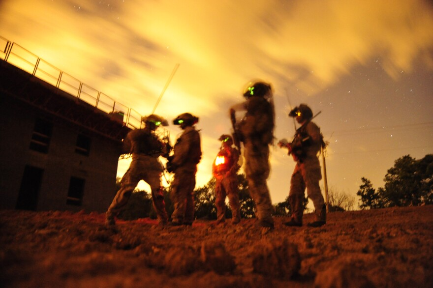 Navy SEALs participate in special operations urban combat training in 2012. The training exercise familiarizes special operators with urban environments and tactical maneuvering during night and day operations.