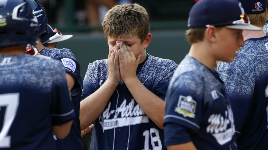 Dylan Rodenhaber (18) of the Red Land team of Lewisberry, Pa., waits to shake hands with players on Tokyo's Kitasuna team after the Little League World Series Championship game Sunday in South Williamsport, Pa.