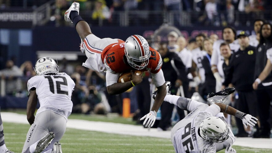 Ohio State quarterback Cardale Jones dives for a first down during the second half of Monday night's game.