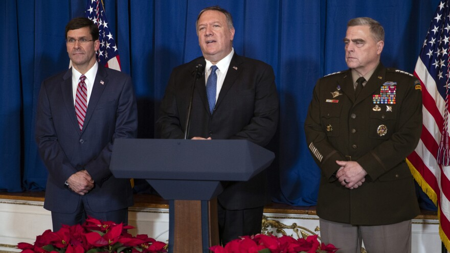 Secretary of Defense Mark Esper, left, and Chairman of the Joint Chiefs of Staff Gen. Mark Milley, right, listen as Secretary of State Mike Pompeo delivers a statement on Iraq and Syria, at President Trump's Mar-a-Lago property, Sunday, Dec. 29, 2019.