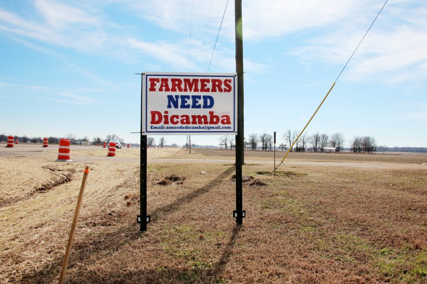 A roadside sign on a field in eastern Arkansas. Dicamba has divided farm communities. Many farmers want to continue using it, despite the risk that they might damage neighboring crops or wild trees.