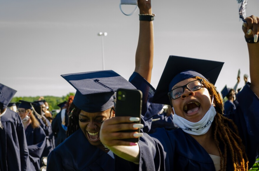 McCluer North High School's Class of 2020 celebrates after graduation Sunday, May 31, 2020.
