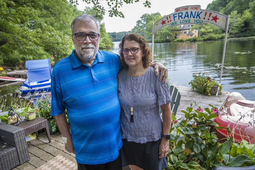 Frank and Leslie Cutitta at their home in Wayland where a banner still hangs for his return from the hospital.