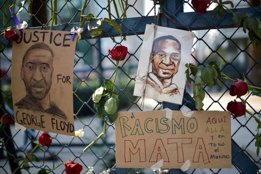 "Portraits of George Floyd have become a fresh symbol of police brutality against black people, and a sign reading, ""Racism kills, here, there and all over the world,"" hung on the fence of the U.S. Embassy in Mexico City on Saturday."