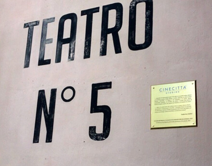 "A plaque featuring a quote from Federico Fellini adorns his favorite studio: ""When I'm asked what city I'd like to live in, London, Paris or Rome, to be honest my answer is Cinecittà. Cinecittà Studio 5 is actually my ideal place, this is how I feel before an empty stage, a place to be filled and a world to be created."""