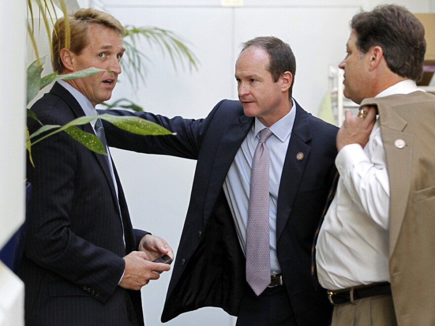 "Republican congressmen Jeff Flake of Arizona, (l) a publicly announced ""no"" vote; John Sullivan of Oklahoma (c), and Bill Shuster of Pennsylvania, Wednesday, July 27, 2011."