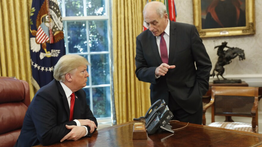 President Trump listens to White House chief of staff John Kelly following Trump's meeting to discuss potential damage from Hurricane Michael in October 2018. Kelly saw his role in the White House as Trump's gatekeeper.