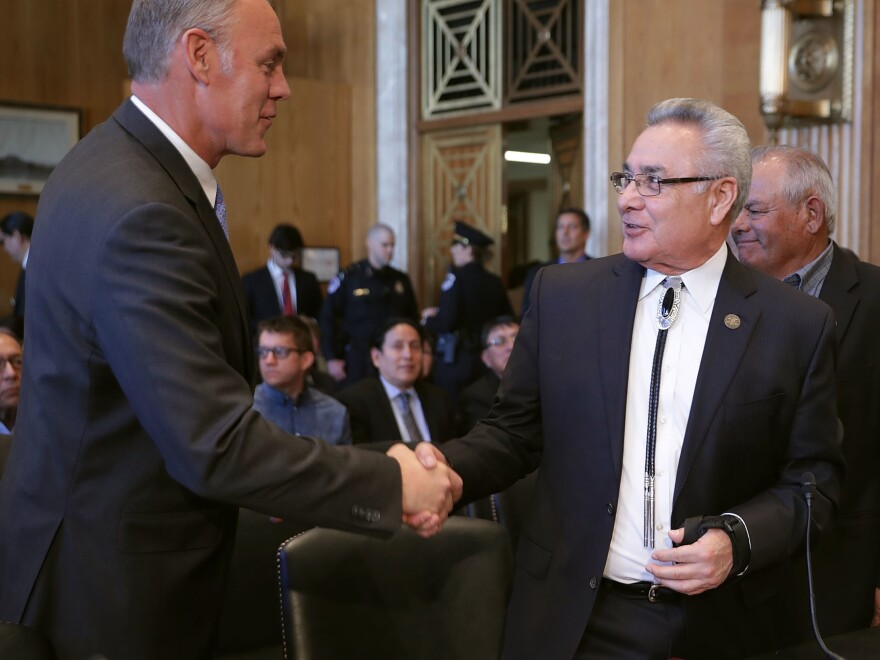 Interior Secretary Ryan Zinke (left) greets National Congress of American Indians President Jefferson Keel before a hearing of the Senate Indian Affairs Committee in March 2017, when both men testified to highlight their priorities for the new Trump administration.