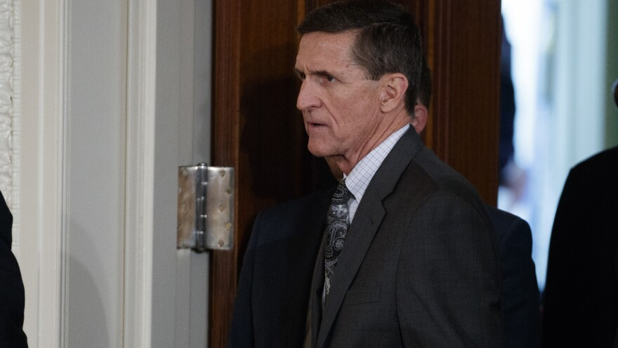 Former national security adviser Michael Flynn's lawyer says Flynn has offered to testify about Trump campaign contacts with Russia if he gets immunity from prosecution. Flynn is seen at the White House on Feb. 13.