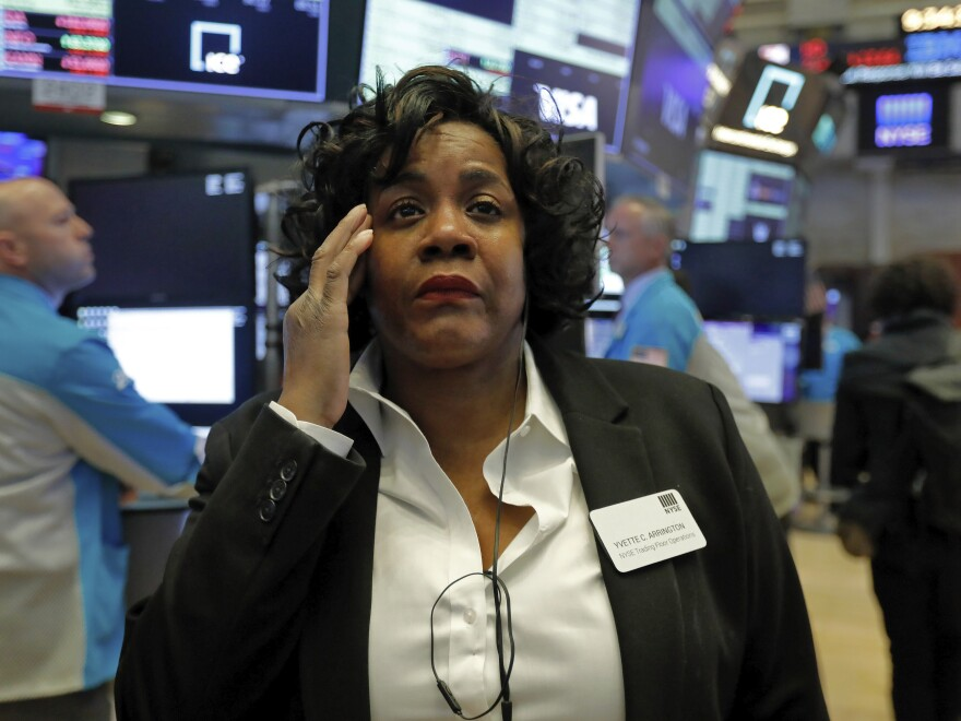 Yvette Arrington with the New York Stock Exchange trading floor operations watches the market slide on March 9 as coronavirus fears grip the financial markets.