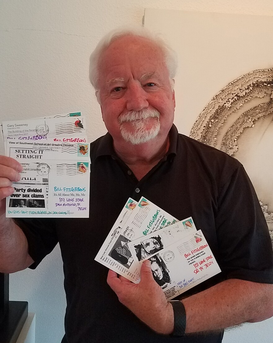 Bill FitzGibbons with his postcards.