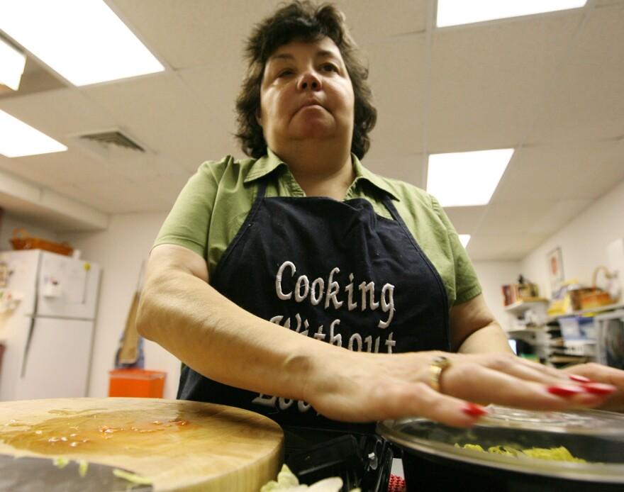 Celia Chacon, a former host of <em>Cooking Without Looking, </em>in the kitchen at Lighthouse of Broward, Fort Lauderdale, Fla., in 2008.  The television cooking show features chefs and guests who are blind or visually impaired.
