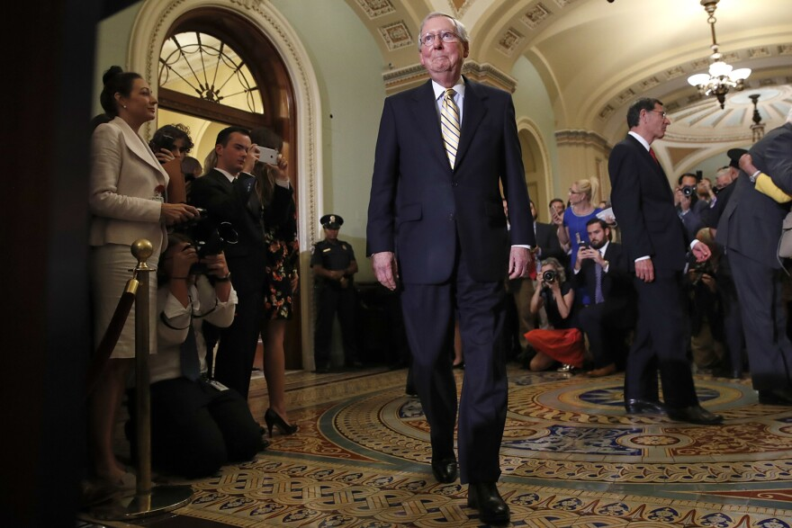 Senate Majority Leader Mitch McConnell of Ky., center, approaches the podium to talk to reporters on Capitol Hill in Washington, Tuesday, July 25, 2017, after Vice President Mike Pence broke a 50-50 tie to start debating Republican legislation to tear down much of the Obama health care law. (Jacquelyn Martin/AP)