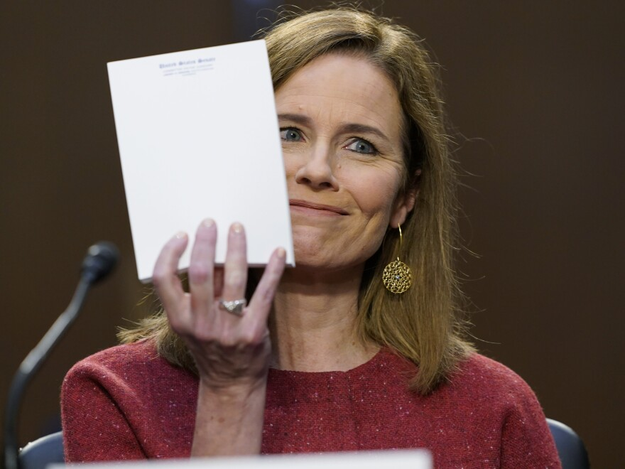 Supreme Court nominee Amy Coney Barrett responds to a question from Sen. John Cornyn, R-Texas, about the materials she used at her hearing on Tuesday: None. She displayed an unused Senate notepad.