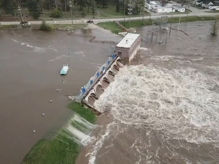 "Water overruns the Sanford Dam in Michigan on Tuesday. The National Weather Service called the flooding ""extremely dangerous"" and said it was caused by ""catastrophic failures"" at two dams."