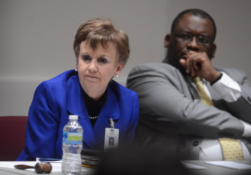 Pat Cotham (left) and Trevor Fuller at a 2013 Mecklenburg County Commission meeting.