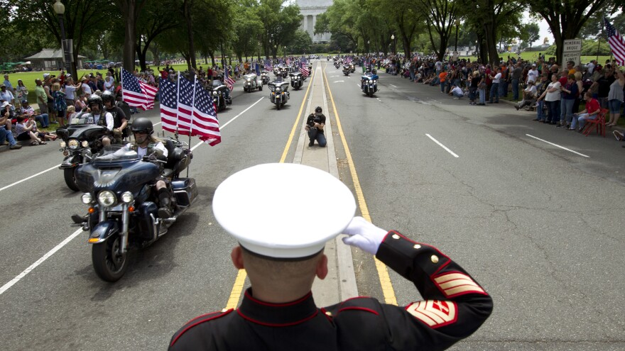U.S. Marine Tim Chambers salutes participants in last year's Rolling Thunder motorcycle demonstration.