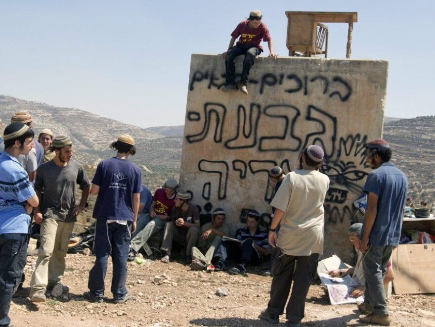 Jewish settlers, known as the Hilltop Youth, gather at an outpost at Itamar in the West Bank on Sept. 8, 2011. The youths were standing watch to see if Israeli security forces were coming to demolish the outpost.