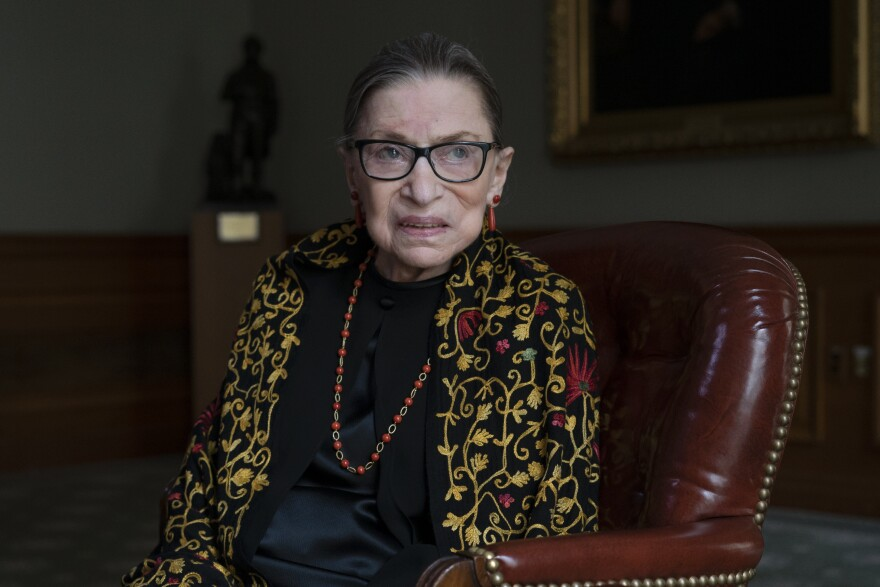 Supreme Court Justice Ruth Bader Ginsburg — here in her chambers during a 2019 interview with NPR's Nina Totenberg — died Sept. 18, 2020, at the age of 87.