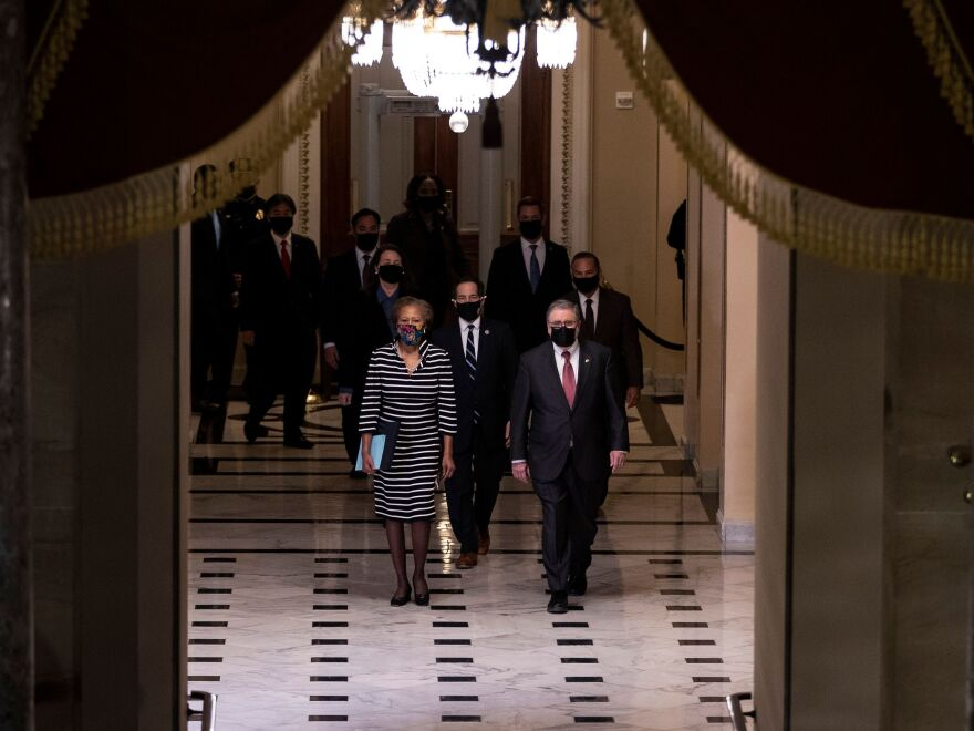 L-R: U.S. House Clerk Cheryl Johnson, Rep. Jamie Raskin and Rep. David Cicilline walk walk through the Capitol's Statuary Hall to deliver the article of impeachment for incitement of insurrection against former President Trump to the Senate floor on Monday evening.